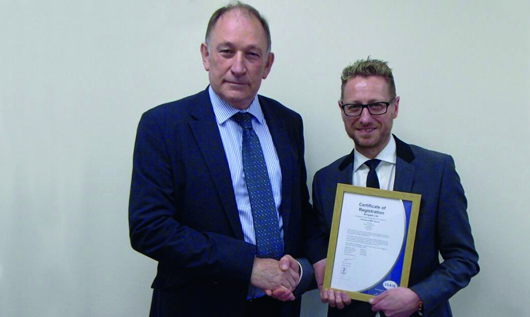 Pictured SSAIB's Chief Executive Alex Carmichael presenting Mark Peretti MRP Alarms Director with the first SSAIB ISO 9001:2015 certificate in 2017.
